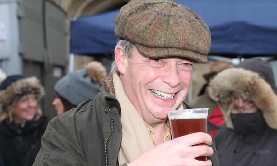 Nigel Farage drinks a pint
