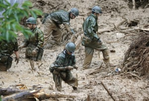 Soldiers search for missing people at a landslide site in Tsunagi town, in Kumamoto prefecture