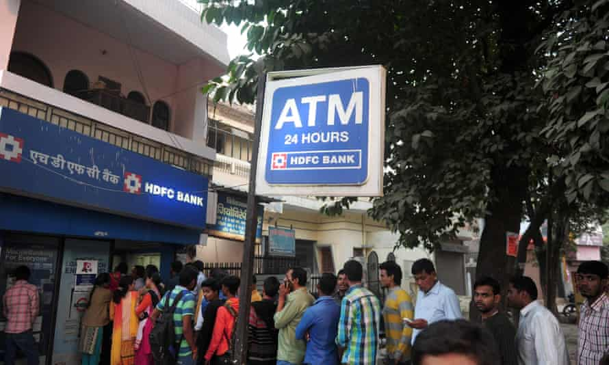 Indians queue outside a bank in Allahabad to exchange 500- and 1,000-rupee notes.