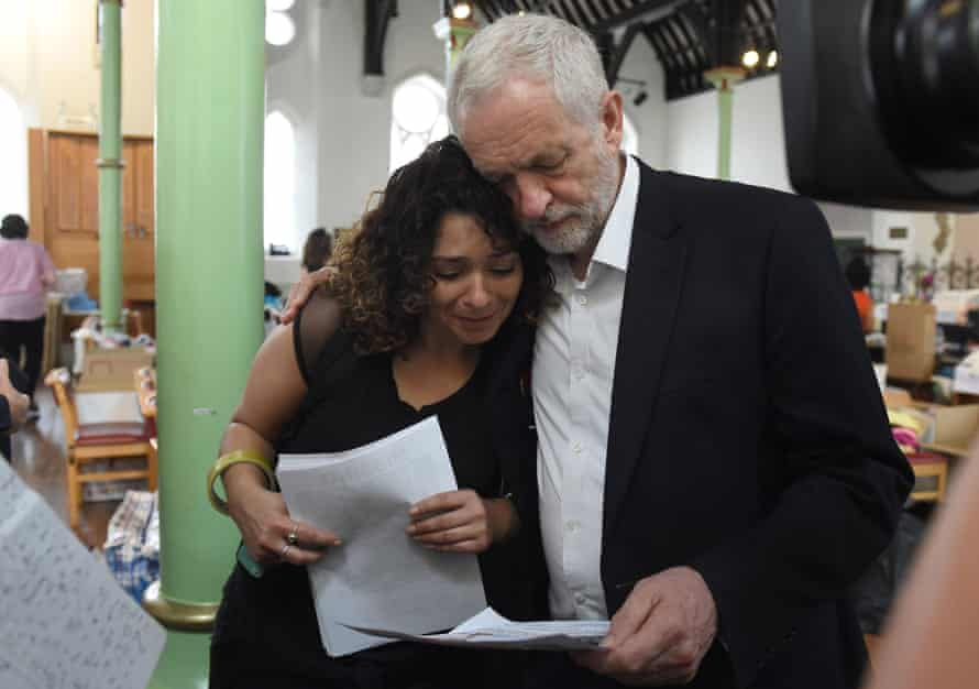 Jeremy Corbyn comforts a woman at St Clement's church in west London, near Grenfell Tower.