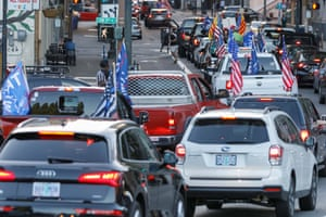 Pickup trucks and cars full of flag-waving Donald Trump supporters as they snarl traffic and parade through downtown Portland, Oregon on August 29, 2020.