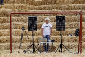 A participant is seen through a goalpost during an amateur football tournament at a stadium made from straw and named Zenit Arena, in the settlement of Krasnoye in Stavropol region