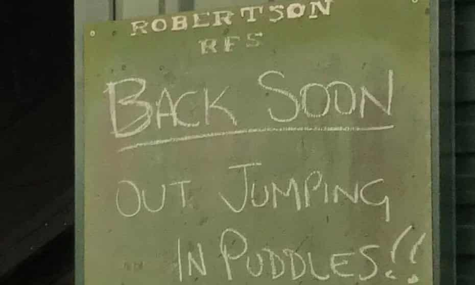 Sign Robertson RFS saying: Out jumping puddles