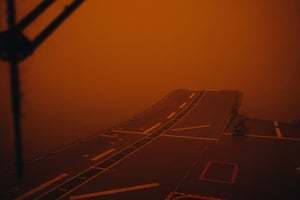 Eden, Australia. The deck of HMAS Adelaide, which has docked off the coast of New South Wales to help fight the bushfires sweeping the country