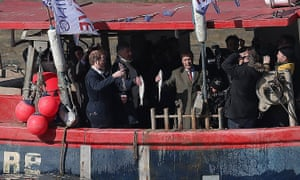 Nigel Farage throws fish into the Thames – a stunt that was filmed by the  BBC