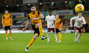 Ruben Neves sends Arsenal keeper Bernd Leno the wrong way to equalise for the home side.