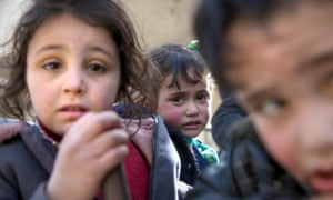 Syrian children flee their homes in the town of Beit Sawa in Syria's besieged eastern Ghouta region.