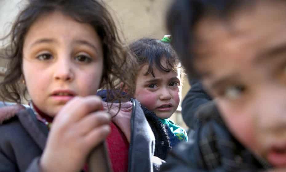 Syrian children flee their homes in the town of Beit Sawa in Syria's besieged eastern Ghouta region.