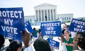 Immigration activists gather outside the US supreme court to await a ruling on the Trump administration's attempt to add a citizenship question to the US census.