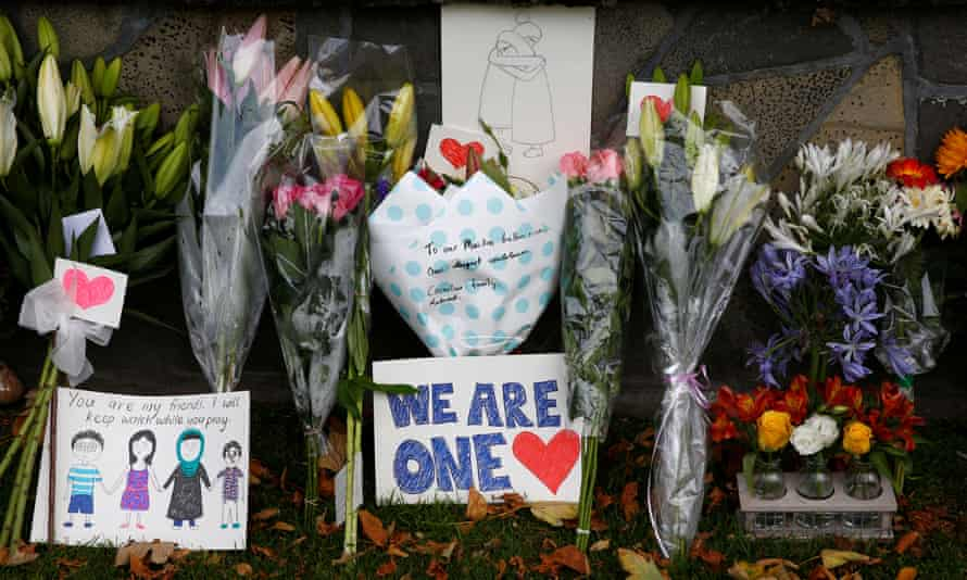 Flowers and signs are seen at a memorial as tributes to victims of the mosque attacks near Linwood mosque in Christchurch