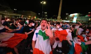 An Italy fan celebrates in Rome.