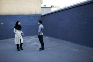 An Iranian couple chats on a street corner in downtown Tehran.