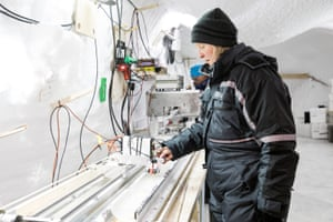 A scientist measures the ice for volcanic ash, acid, ice crystal properties