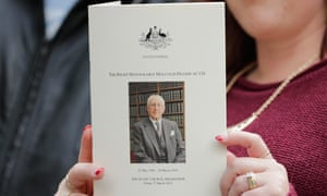 A woman holds the funeral program at Scots Church during the State Funeral for the Right Honourable Malcolm Fraser on March 27, 2015 in Melbourne, Australia.