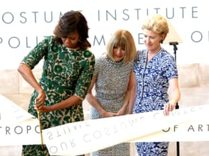 Watching on as Michelle Obama cuts the ribbon at the opening of the Anna Wintour Costume Center at the Metropolitan Museum of Art, New York, 2014.