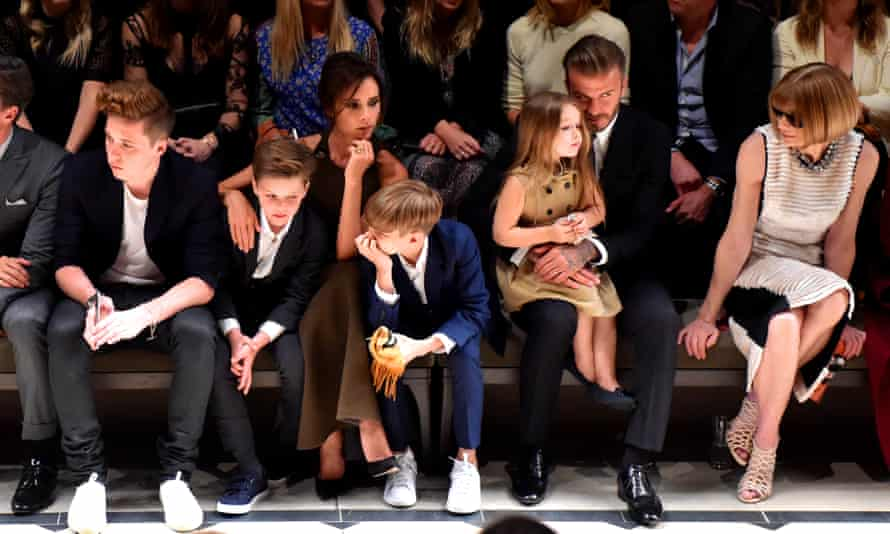 David and Victoria Beckham with their children at a fashion show in Los Angeles last year