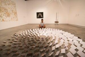 Hazara refugee Sha Sarwari with his artwork Silent Conversation.