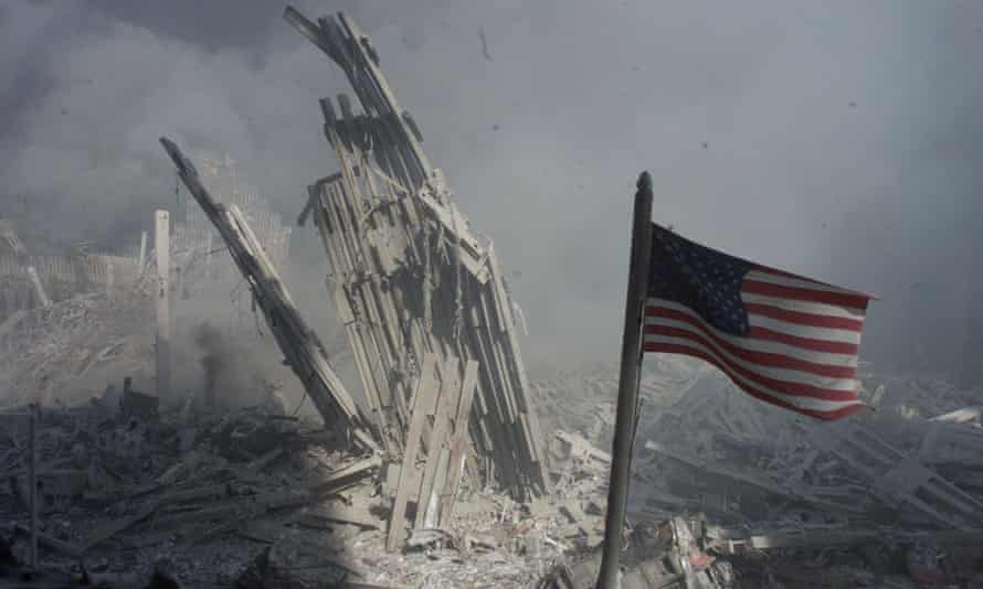 An American flag flies near the base of the destroyed World Trade Center in New York on 11 September 2001.