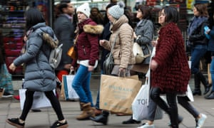 Shoppers carry bags along London's Oxford Street.