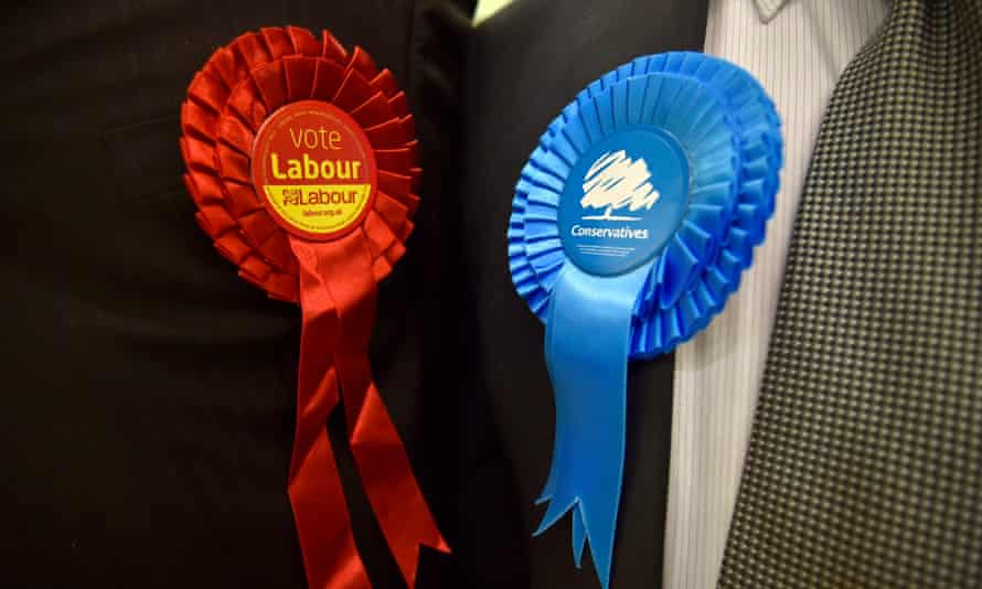 Conservative and Labour rosettes