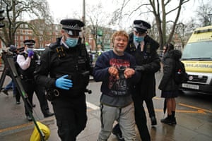 A protester is removed by police from the camp