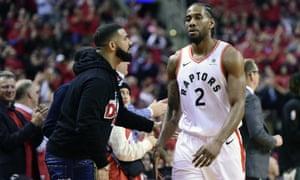 Drake congratulates Kawhi Leonard as the Raptors make their way towards victory.