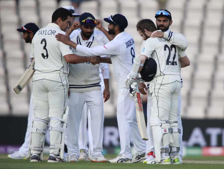 India's captain Virat Kohli, right, congratulates Kane Williamson