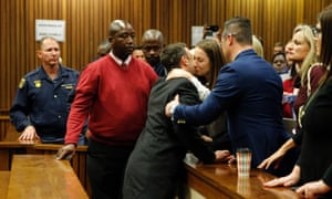 Oscar Pistorius says goodbye to his sister Aimee Pistorius before being taken down to the cells.