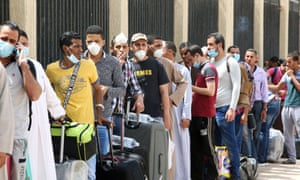 Egyptians queue up outside a school turned into a centre to receive residency violators wishing to avail an amnesty Kuwait announced for April.