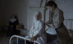 Agata Kulesza, Joanna Kulig and Lou de Laâge in a scene from The Innocents.