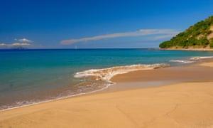 An empty sandy beach and azure sea