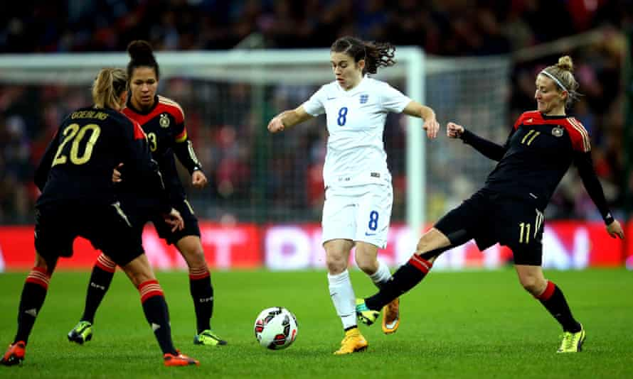 Karen Carney tries to escape the attention of three Germany players during the 2014 match.