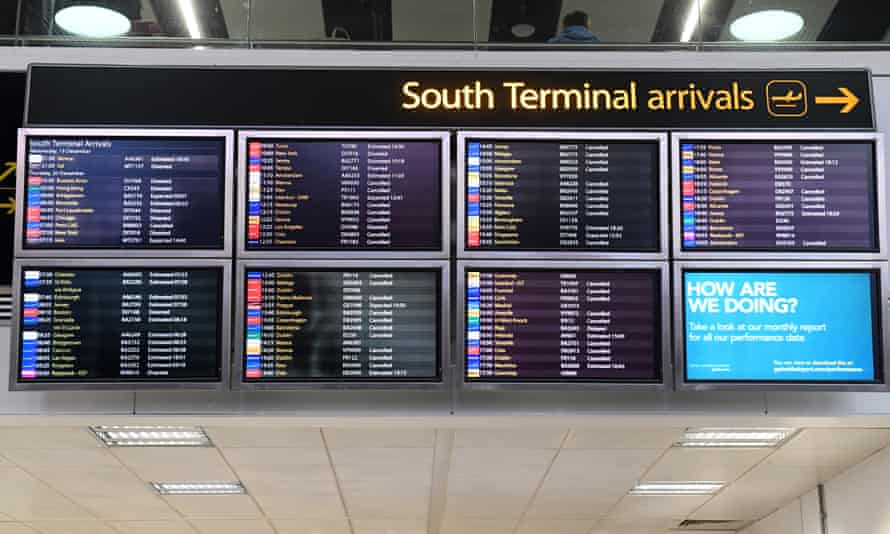 A screen displays information on flight disruption at Gatwick airport