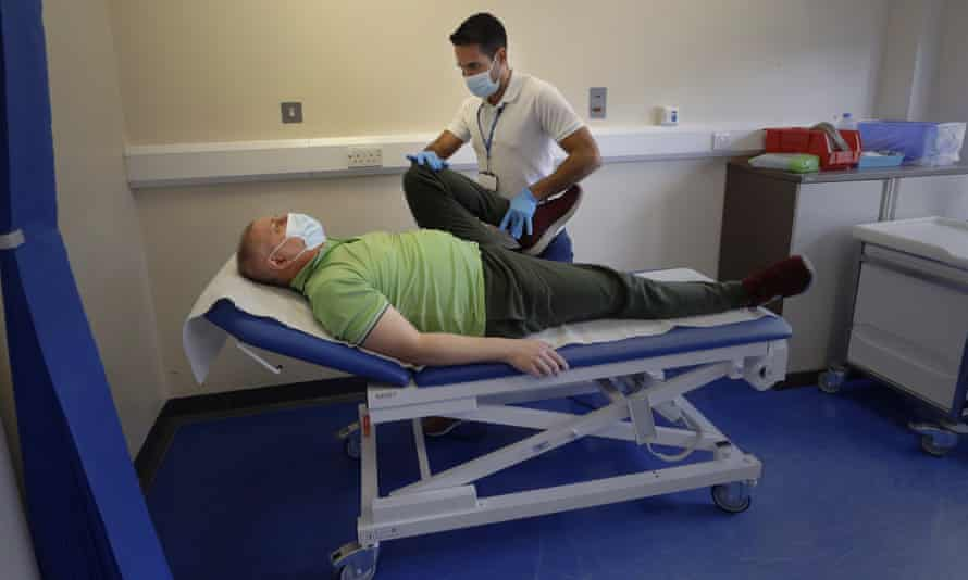 Long Covid patient Gary Miller receives treatment at the King George hospital in Ilford, London