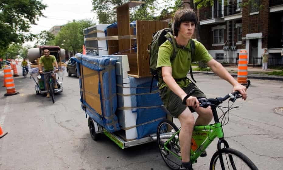 Bicycle movers Gabriel Laporte, front, and Dominique Thibaut cycle through Montreal. Around 10% of the city's 1.6 million people are said to be moving house in any given year – largely on Moving Day.