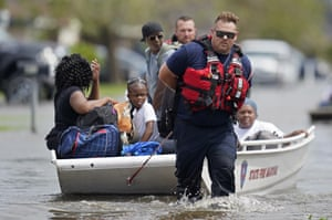Members of the Louisiana State Fire Marshal's office rescue people from floodwaters in the aftermath of Hurricane Ida in New Orleans.