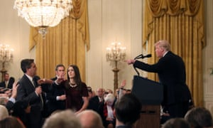 A White House staff member reaches for the microphone held by CNN's Jim Acosta as he questions U.S. President Donald Trump during a news conference in WashingtonA White House staff member reaches for the microphone held by CNN's Jim Acosta as he questions U.S. President Donald Trump during a news conference following Tuesday's midterm U.S. congressional elections at the White House in Washington, U.S., November 7, 2018. REUTERS/Jonathan Ernst TPX IMAGES OF THE DAY