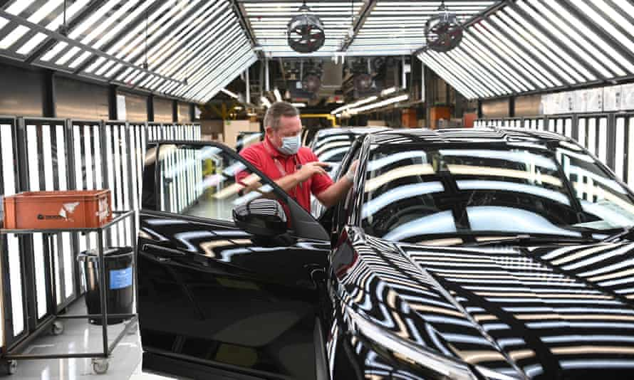 A Nissan employee make final checks to cars on the production line at the Sunderland factory.