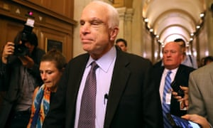 """John McCain leaves the the Senate chamber after voting down the GOP """"Skinny Repeal"""" healthcare bill."""