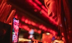 Singer and blogger Yuan Qinggai livestreams from the bar at 44KW nightclub in Shanghai