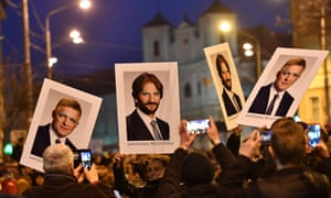 Placards bearing altered portraits of prime minister Robert Fico and interior minister Robert Kaliňák on Friday.