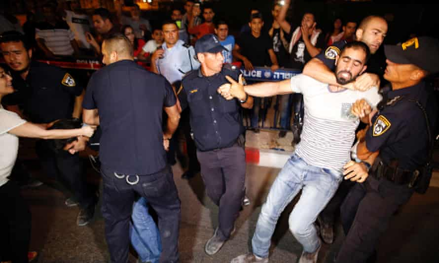 Israeli police arrest a Palestinian protester during a demonstration against detention and in support of Palestinian prisoner Bilal Kayed.