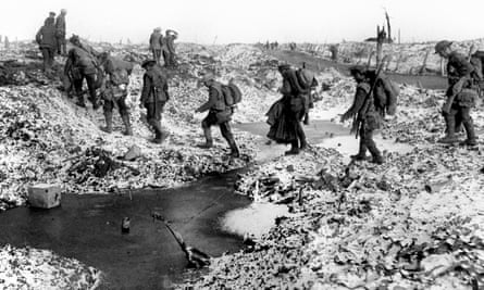 British soldiers negotiating a shell-cratered, winter landscape along the River Somme in late 1916