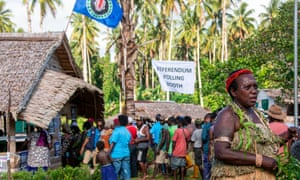 People queue to vote at a polling station in the capital Buka in an historical independence vote on November 25, 2019 in a vote that could create the world's newest nation.