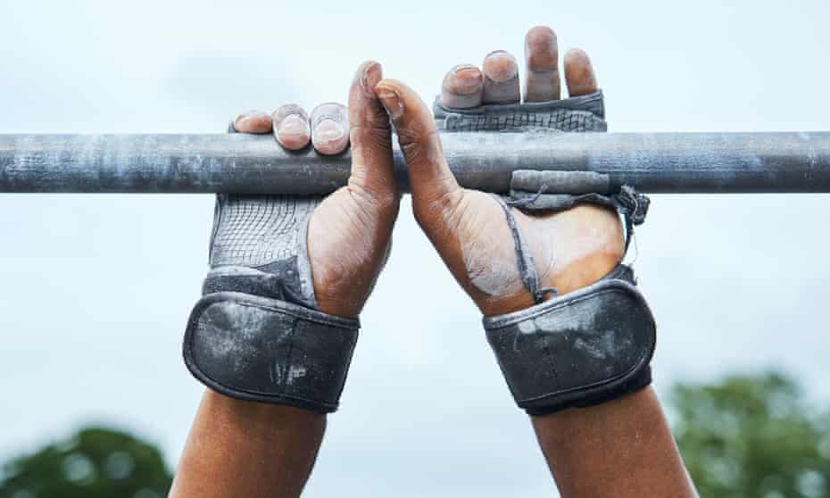 Get a grip: worn gloves covered in chalk help the athletes perform their moves on the bars.