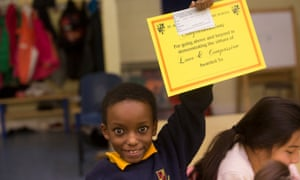 A child  holding a certificate