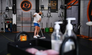 A Sydney gym employee prepares to reopen.