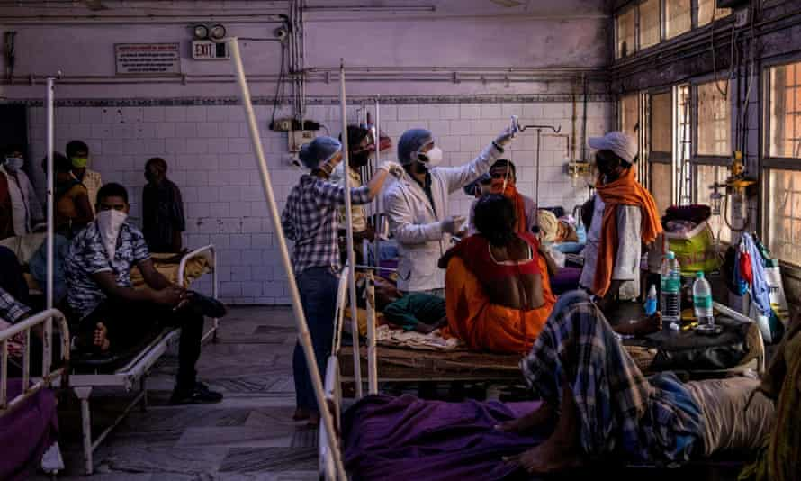 Medical staff treat a patient inside the emergency ward of Jawahar Lal Nehru medical college and hospital, during the coronavirus outbreak, in Bhagalpur, Bihar.