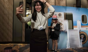 A woman poses for a selfie at an election event organised by the US embassy in Seoul, South Korea.