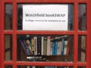 Second-hand book sharing in an old red telephone box
